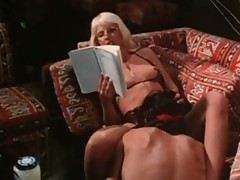 Hot blonde babe pounded hard in a vintage porn video