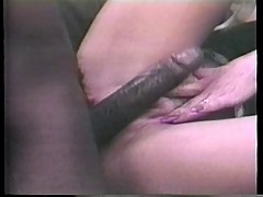 Bond whore in classic porn flick rides a black cock