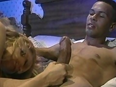 Mature blonde bitch rides a young cock