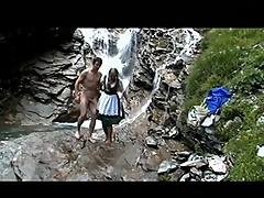 Nasty couple makes out in the waterfall